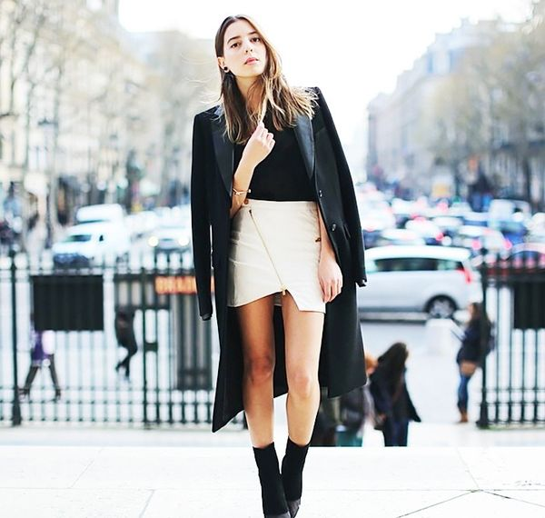 While a typical A-line skirt breaks up your legs, causing them to look shorter, a skirt with a side or asymmetrical slit actually extends the natural line of your leg.