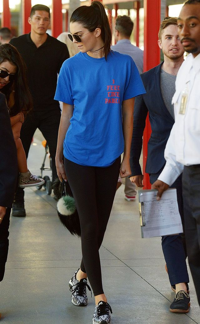 Style Notes:Tour tees are also key to Kendall's athleisure look. She paired a blue Pablo tour T-shirt with black exercise leggings, monochrome trainers and a furry Givenchy bag.
