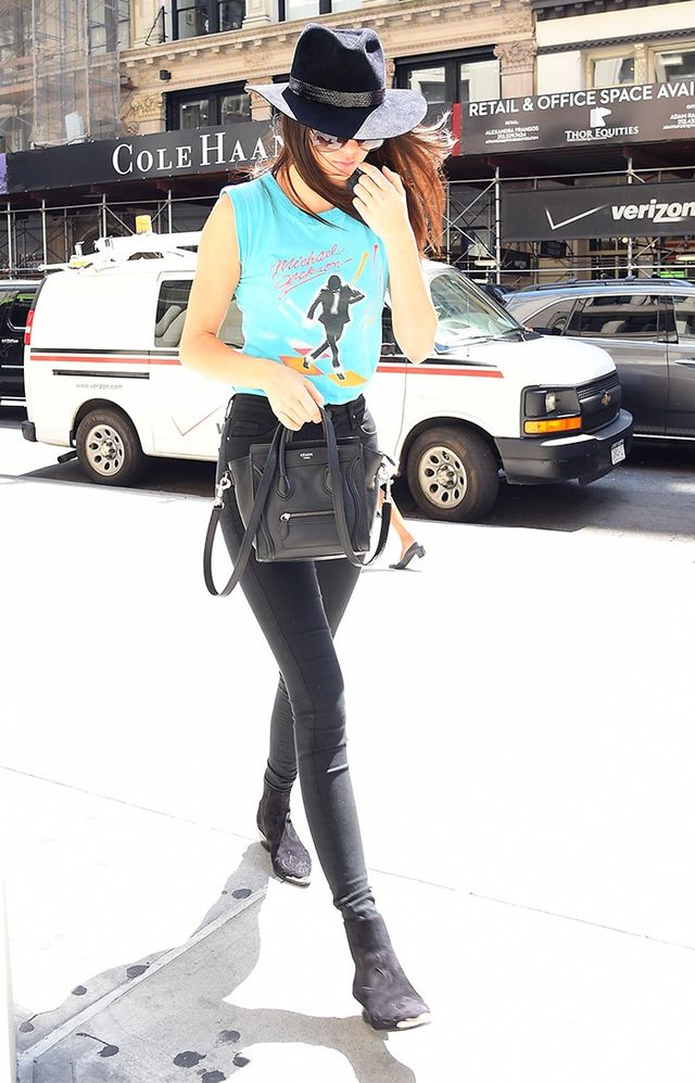 Style Notes:Kendall shows that you don't have to stick to grunge colour palettes, wearing an electric turquoiseMichael Jackson tee with, but of course, a Michael Jackson-esque...
