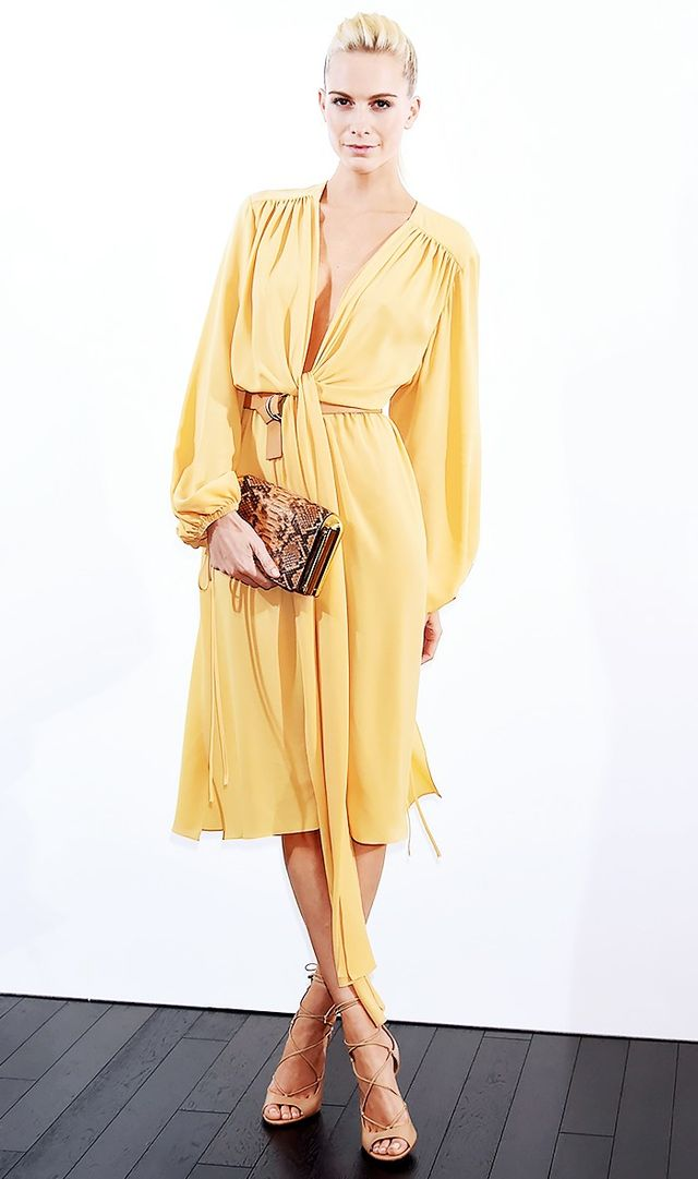 Bright colors are your friends. Yellow is a popular choice this spring, and here, Poppy Delevingne shows us just how chic it can be when worn with neutral heels and a cutting-edge snake-print clutch.