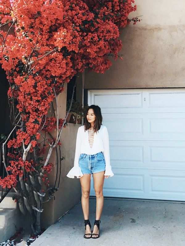 Style Notes: Super blogger Aimee Song of Song of Style treads a similar path with her combination of high-waisted jean shorts and a dramatic Stone Cold Fox Powell...