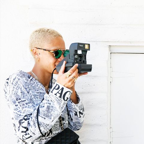 adwoa aboah style: taking pictures at Coachella with a Chanel handbag