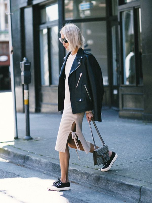 Style Notes: Vanessa Hong ofThe Haute Pursuitpairs a light sweater dress against bare skin and Supergasneakers.