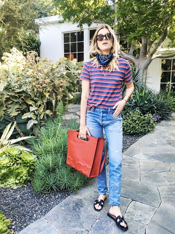 Style Notes:In addition to Camille Charrière's perfectly assembled straight leg, striped tee, Hermes must-have flats, andGuccitote extravaganza, it's the natty way...