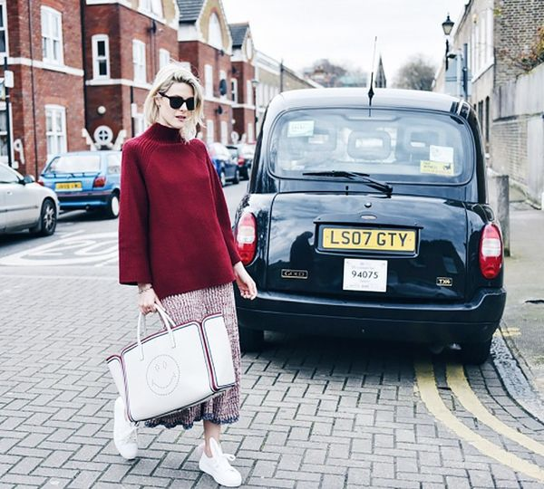 Style Notes: Sofie Valkiers of Fashionataknows the most of-the-moment way to wear a midi skirt is with a long layer over the top—so forget tucking in for now.