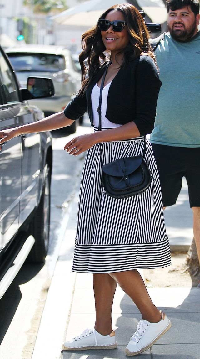 On Gabrielle Union: Forever 21 Stripe Pleated Skirt ($18) and Faux Leather Crossbody ($23); Soludos Platform Tennis Sneakers ($159).