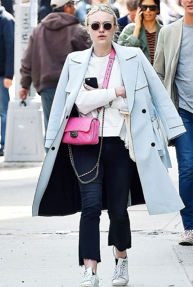 On Dakota Fanning: Mother Insider Crop Step Fray Jeans in Wait Until Dark ($225); Storets Sharp End Varsity Top ($78); Topshop Bonded Belted Truster Coat; Super by Retrosuperfuture Panama...
