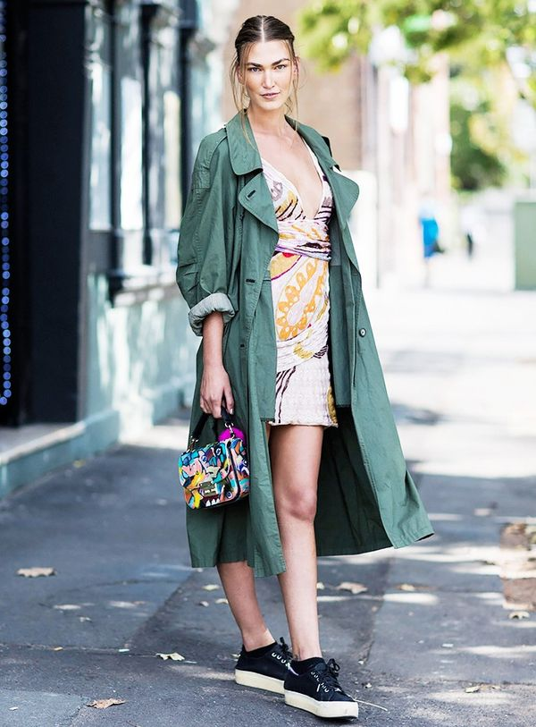 Wear your most flirty dress with a classic trench coat. Leave it open so you don't feel trapped by the heat and so everyone can admire the gorgeous frock underneath.