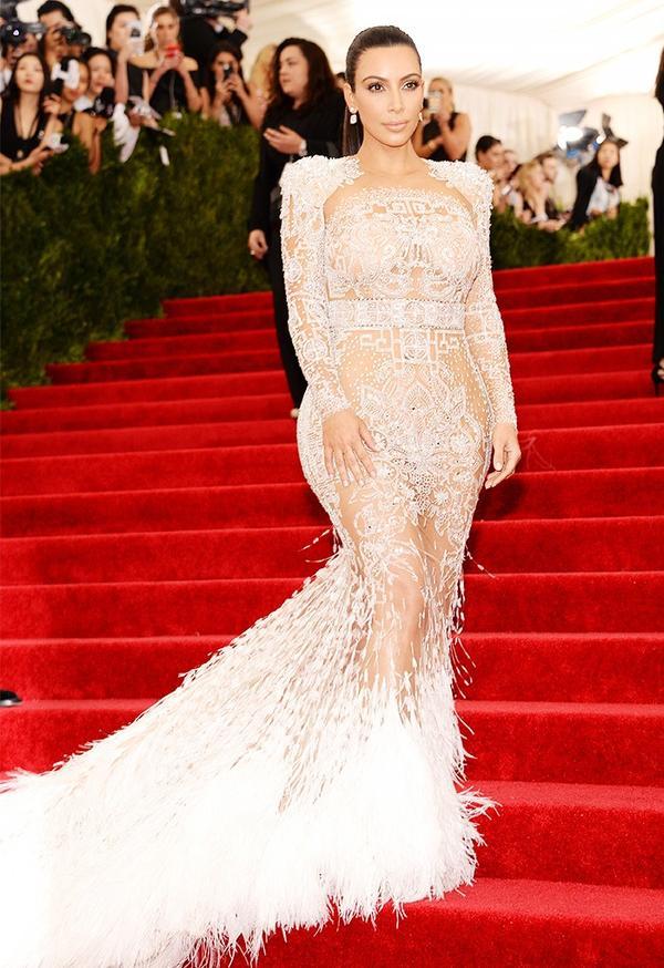 WHO:Kim Kardashian WEAR:Roberto Cavalli by Peter Dundas gown.