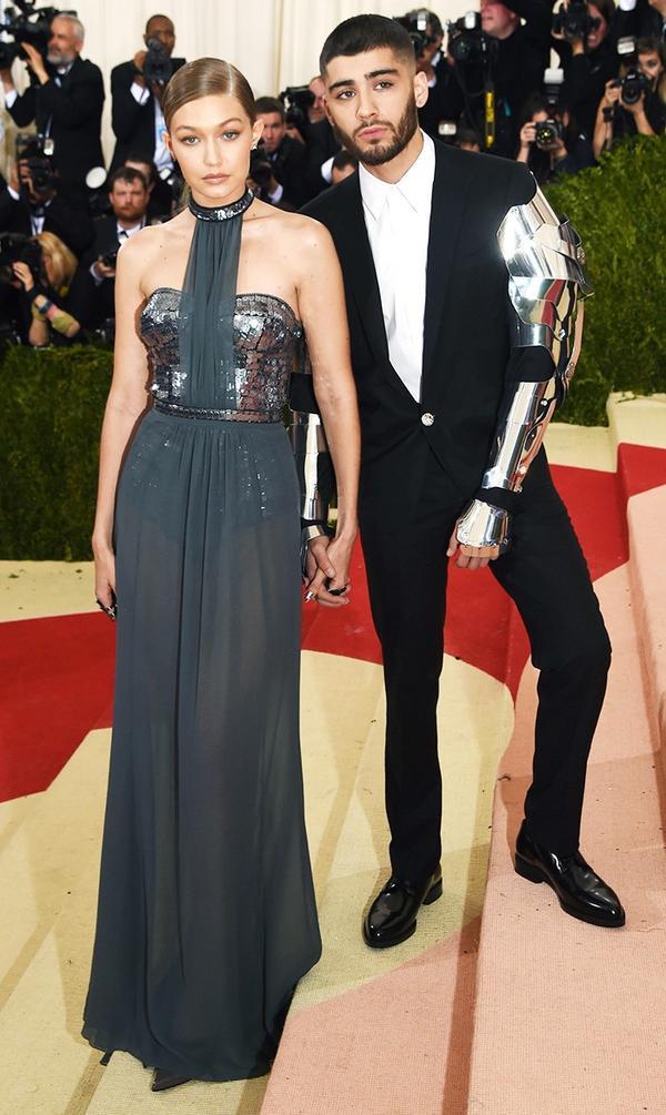 WHO: Gigi Hadid and Zayn Malik WEAR: Tommy Hilfiger dress and Versace suit.
