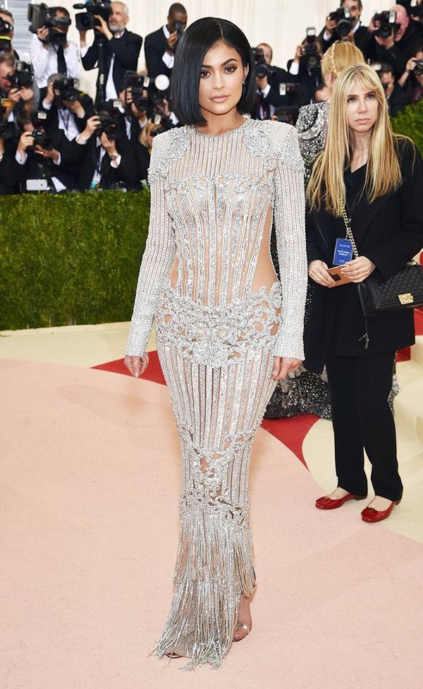 WHO: Kylie Jenner WEAR: Balmain gown;Lorraine Schwartz jewelry; Aquazzura sandals.