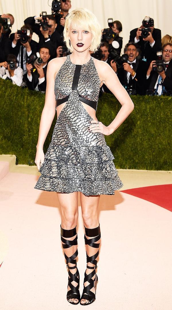 WHO: Taylor Swift WEAR: Louis Vuitton dress; Eva Fehren jewellery.