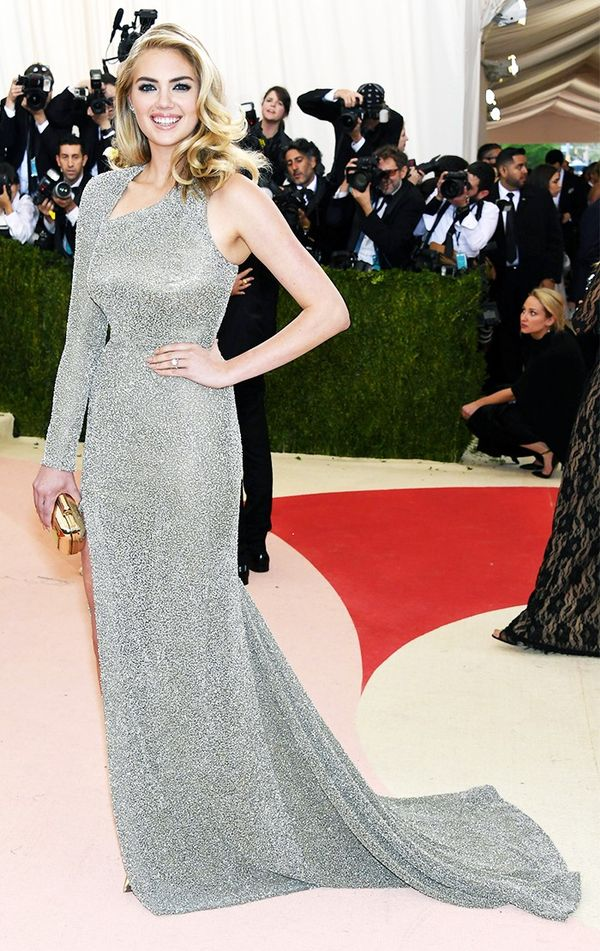 WHO: Kate Upton WEAR:Topshop gown; Jimmy Choo clutch.