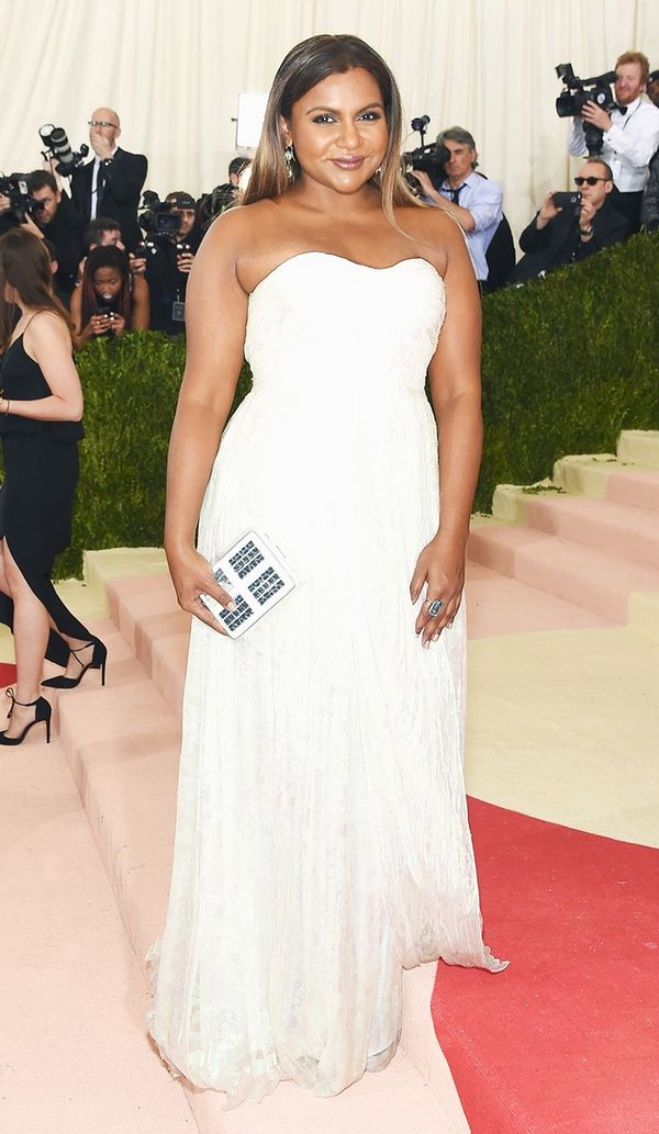 WHO: Mindy Kaling WEAR: Tory Burch gown; Jimmy Choo sandals.