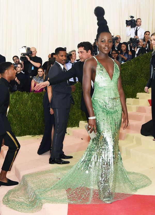 WHO: Lupita Nyong'o WEAR: Calvin Klein Collection gown; Tiffany & Co. jewels; Jimmy Choo sandals.