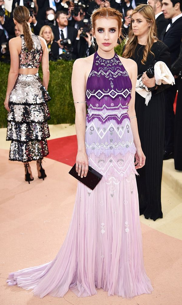 WHO: Emma Roberts WEAR:Tory Burch gown; Edie Parker clutch.