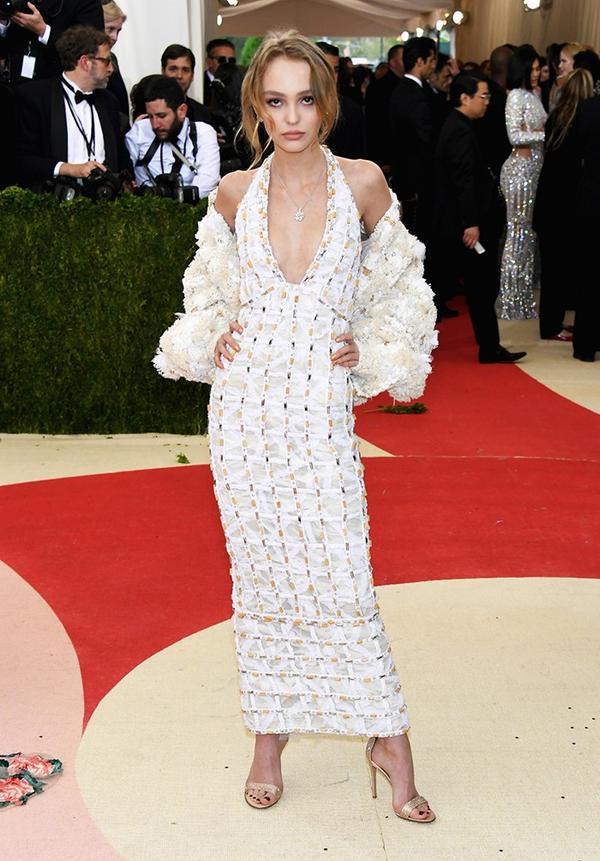 WHO: Lily-Rose Depp WEAR: Chanel dress; Gianvito Rossi heels.