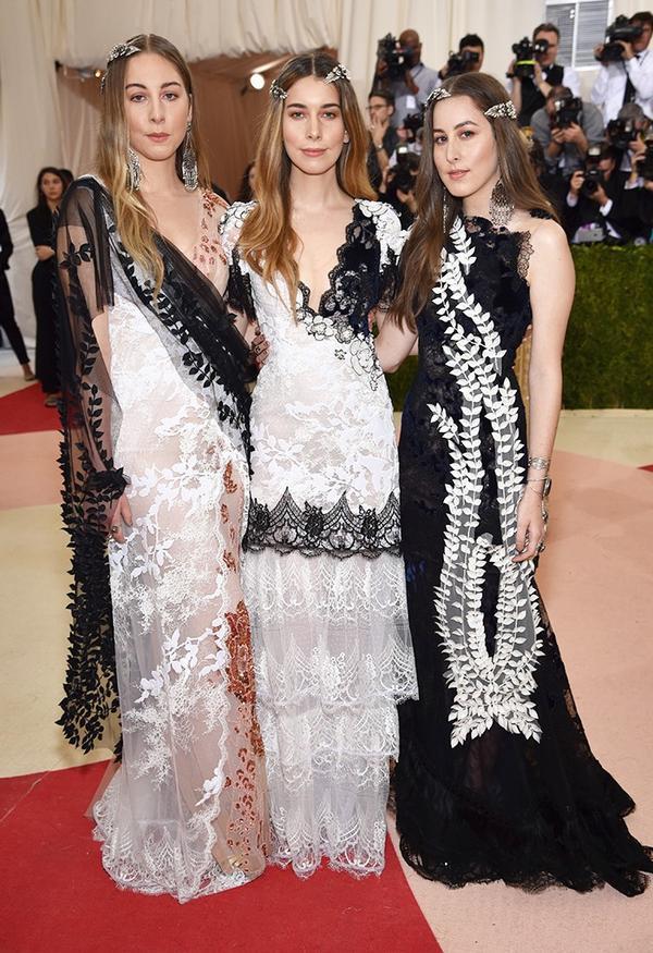 WHO: Este, Danielle, and Alana Haim WEAR: Rodarte gowns.