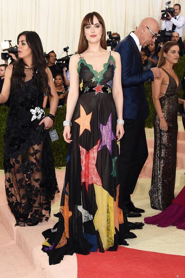 WHO: Dakota Johnson WEAR: Gucci gown.