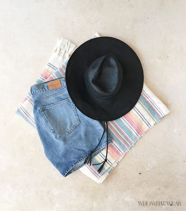 I'm prone to sunburns, so in addition to my frequently applied sunblock, I also tossed on this cute drawstring sombrero. Get the Look: Madewell Packable Straw Hat (£32); M.i.h...