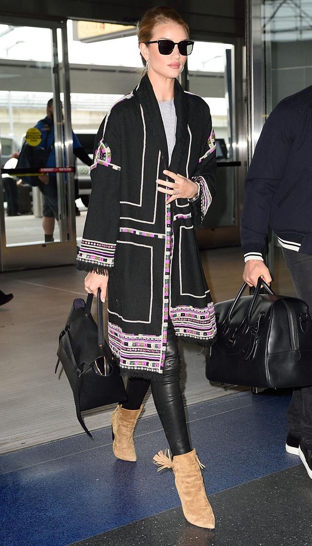 On Rosie Huntington-Whiteley: Isabel Marant Bering Embellished Wool Coat (£2105); Ragdoll Vintage Tee(£47); Paige Denim Verdugo Leather Pants (£626/£438);Saint...