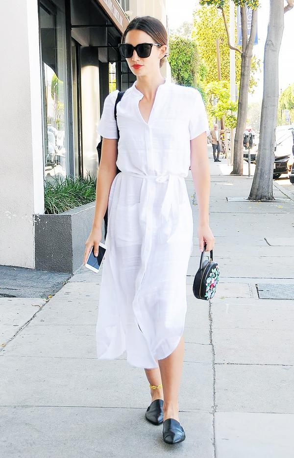 On Lily Aldridge: Reformation Ghana Dress(£151) in Eco Riviera; Jenni Kayne loafers.