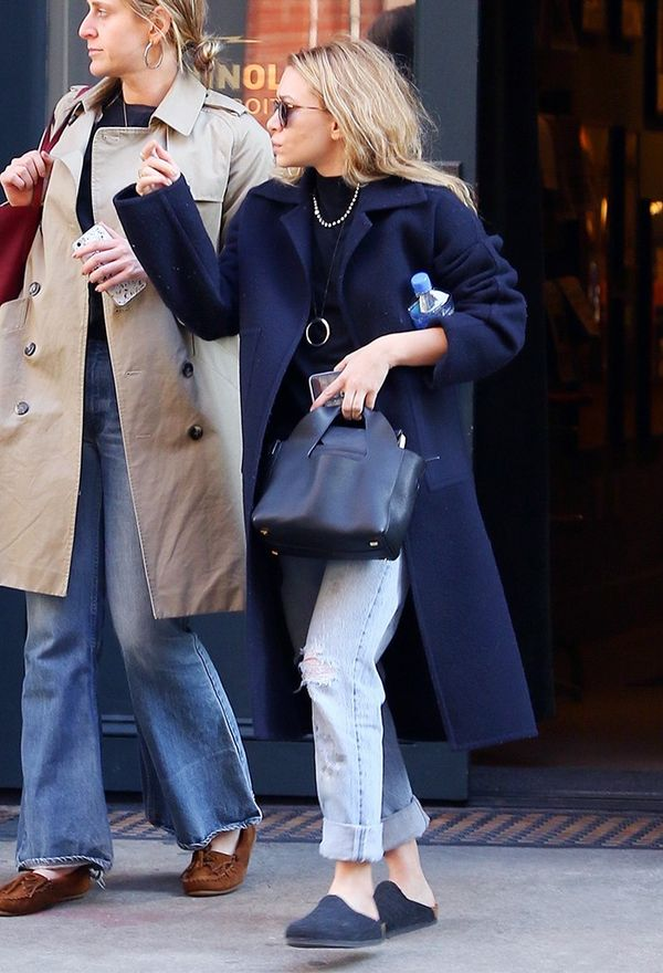 On Ashley Olsen: Oliver Peoples O'Malley Sunglasses ($450); The Row Two for One Pouch ($1995); Birkenstock Amsterdam Shoes ($100).
