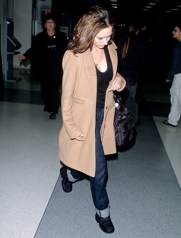 Please observe the coziness that is Jennifer Love Hewitt's camel coat–and–cuffed jeans pairing.
