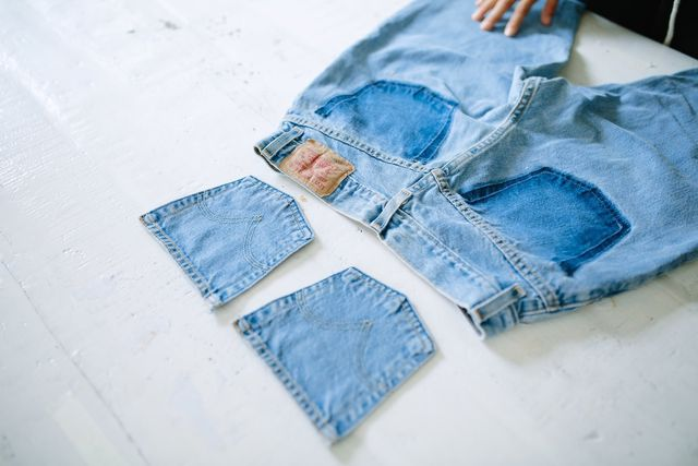 Decide on the position you want to re-sew the pockets. This will depend on how much of the dark pocket imprint you want to show-off.