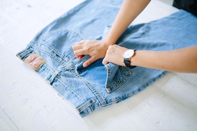After unpicking a couple of centimetres, you can move things along faster by ripping the pockets off.