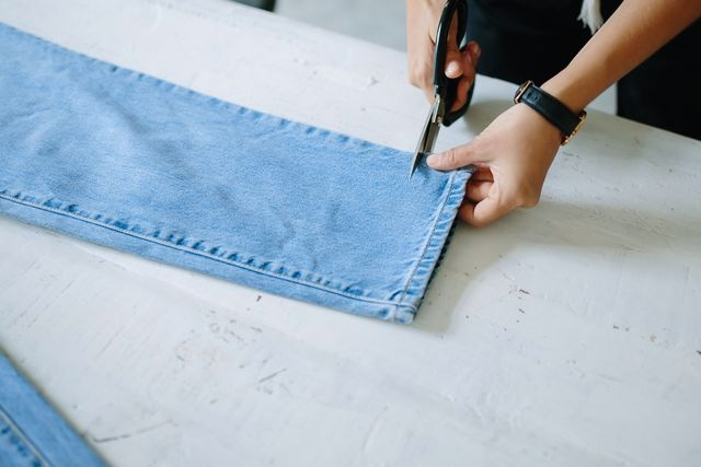 Then cut straight along the front of the pant leg.