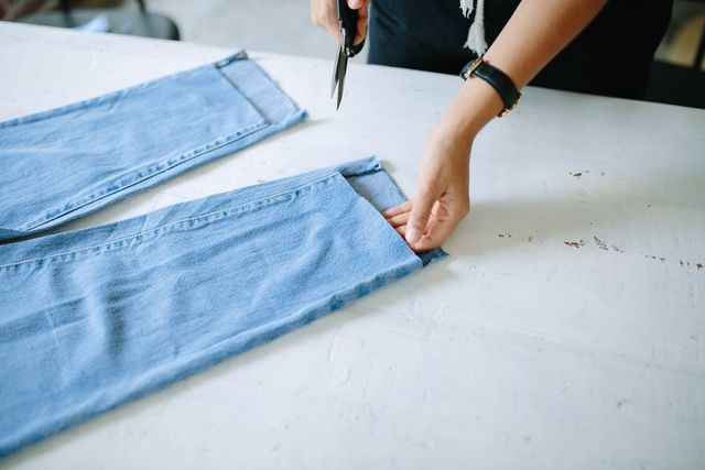 """You will end up with a """"step"""" in the leg hem. Cut the hem off the back of the leg to make that a raw edge too."""