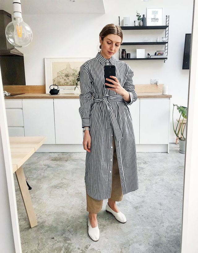 Spring street style outfit ideas 2018: layer a striped shirt dress over culottes and wear with glove pumps