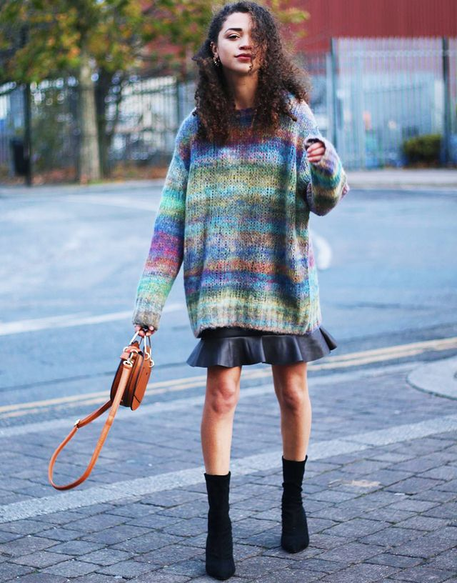Spring street style outfit ideas 2018: wear an oversized sweater with a mini skirt and ankle boots