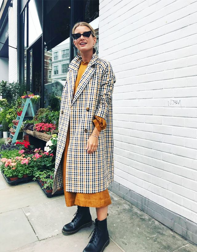 Spring street style outfit ideas 2018: checked trench coat with an orange dress and Dr. Martens boots