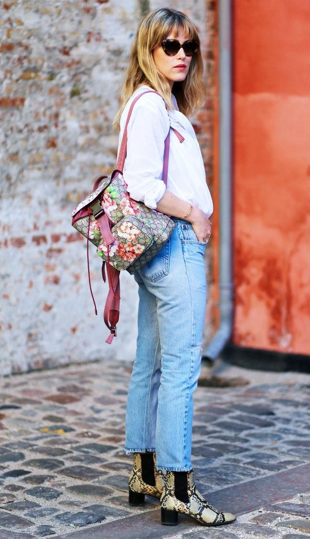 On Annabel Rosendahl: Prada sunglasses; Gucci bag (shop similar); Helmut Lang shirt; Re/done jeans; Isabel Marant boots. Style Notes: Add an unexpected clash of accessories, and incorporate...