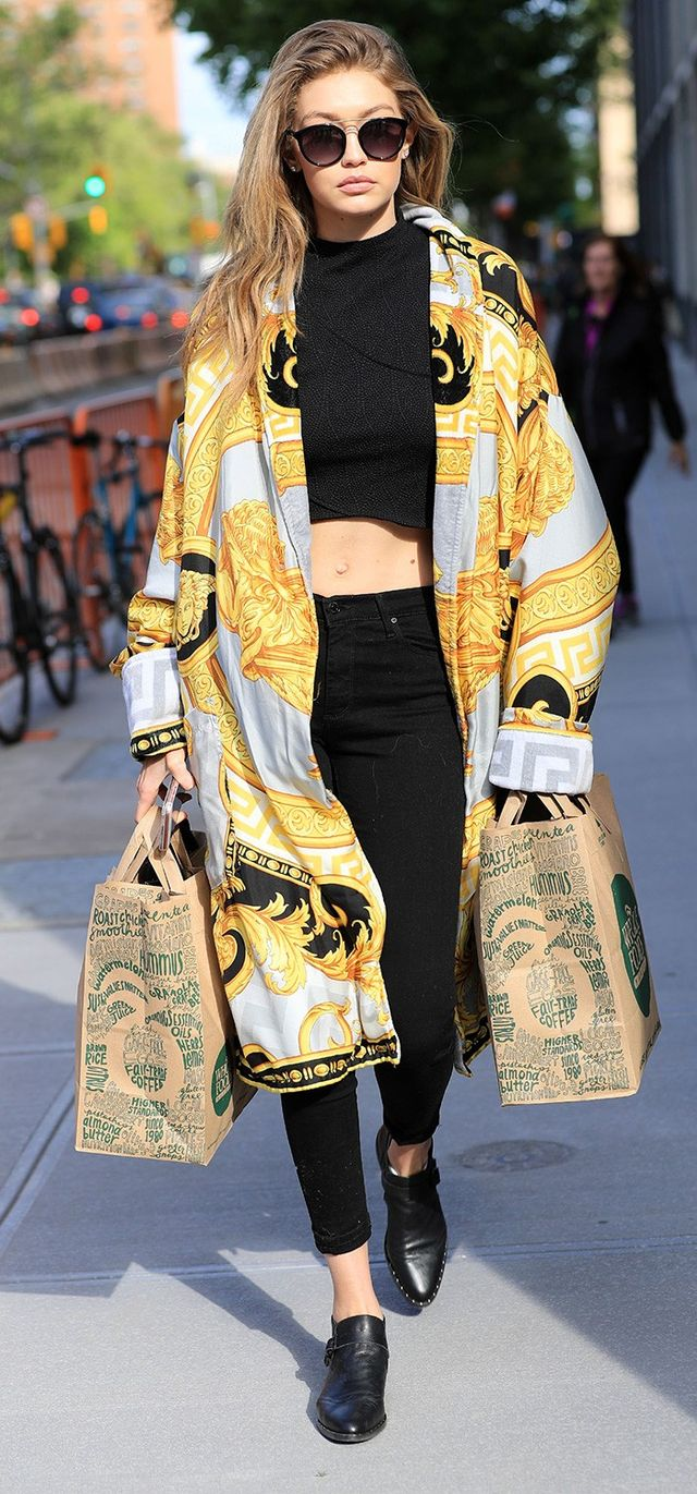 On Gigi Hadid: Twenty Studded Jacquard Top (£101); Versace coat and Medusa Tote (£2166); Parker Smith Ava Skinny Jeans (£104) in Eternal...