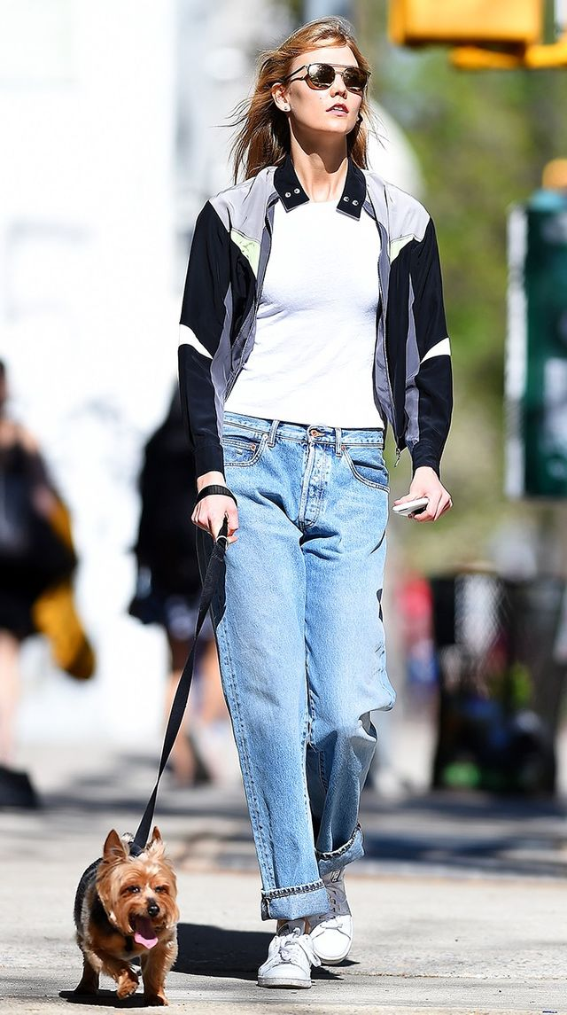 Karlie Kloss styles her slouchy jeans with a simple long-line tee and sneakers for an easy weekend look. On Karlie Kloss: Louis Vuitton jacket; Re/Done jean; Adidas Originals Stan Smith...