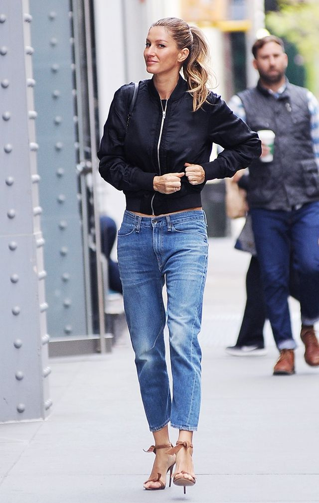 Gisele Bündchen contrasts her casual bomber jacket and jeans with a pair of heeled sandals—just a sliver of skin makes this idea doable on a daily basis.On Gisele Bündchen: T...