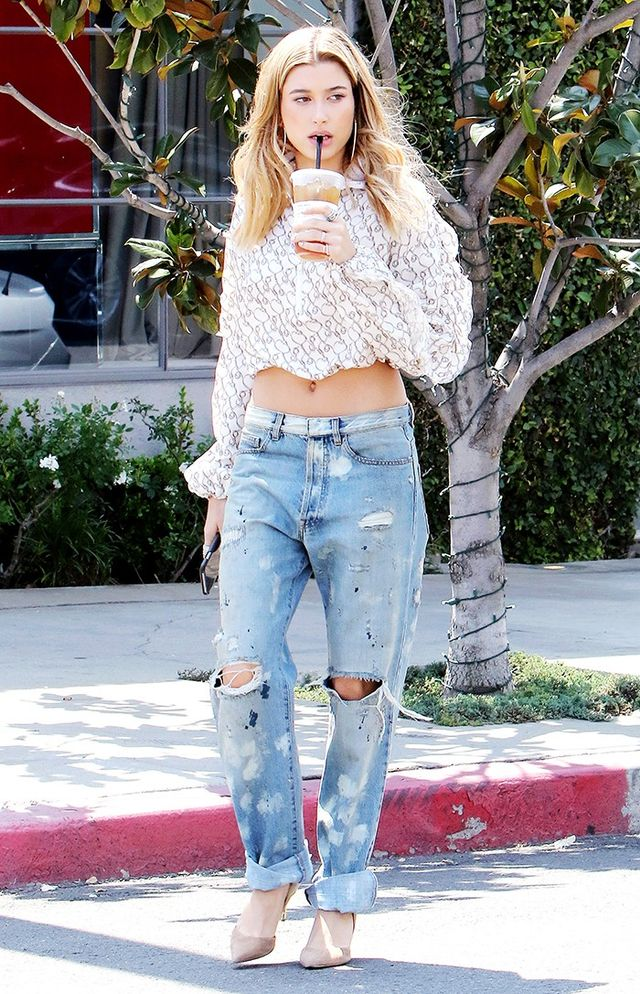 If you're up for a bare-stomach moment, try a look like Hailey Baldwin's. She teamed a lacy crop top with baggy, distressed jeans and finished it all off with nude heels—it's the loose fits...