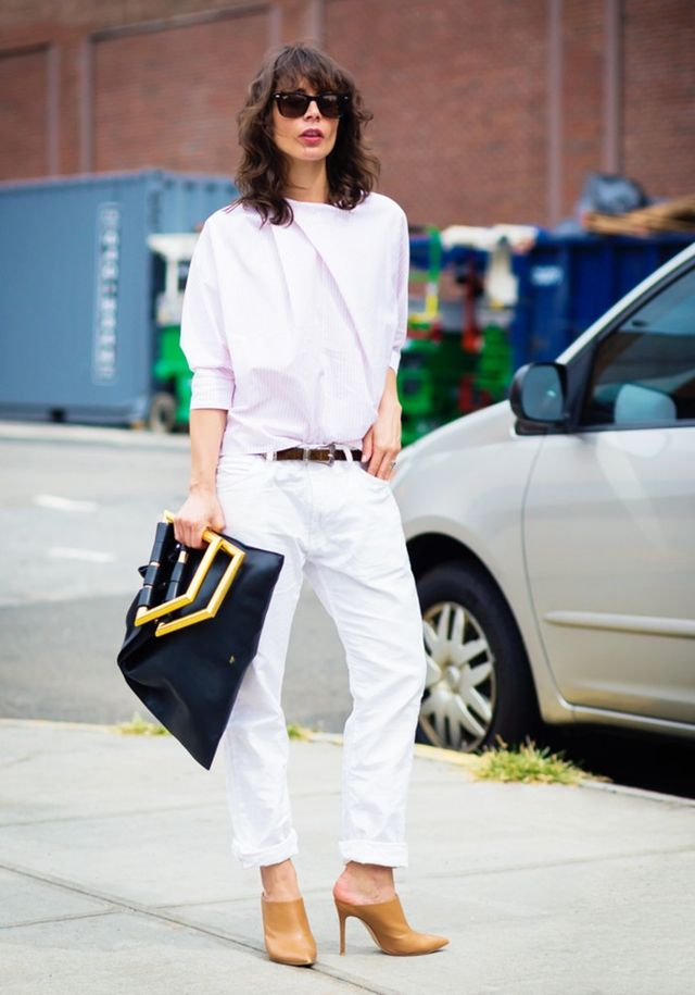 Uneasy about wearing white pants? Try fashion blogger Irina Lakicevic's approach and find an extra roomy version that you can pair with a polished blouse and mules.
