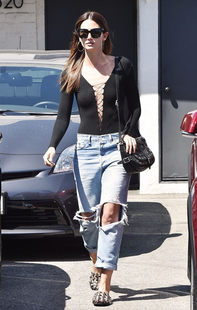 Lily Aldridge tempers the sexiness of a lace-up bodysuit by wearing it with ripped jeans and slides.On Lily Aldridge: T by Alexander Wang Lace-Up Stretch Jersey Bodysuit (£117); Re/Done...