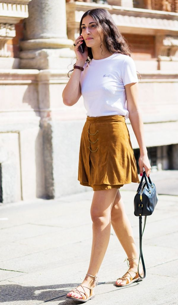 Don't know how to wear your suede skirt in the summer? Tuck in your favourite white T-shirt, slip into some lace-up sandals, and you're ready for a perfect summer day.