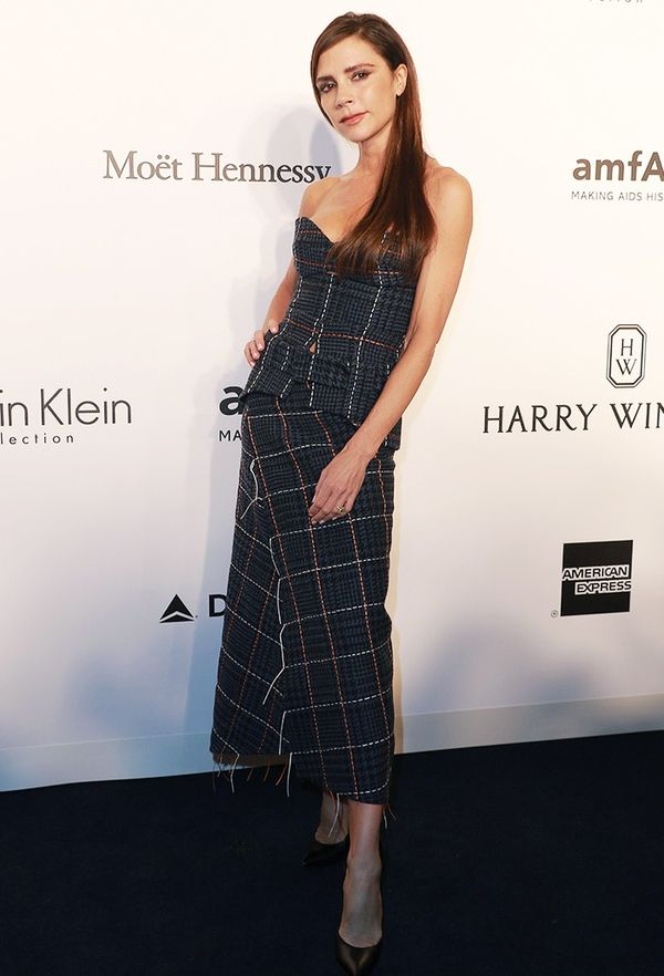 How to look taller: Victoria Beckham in a checked top and skirt