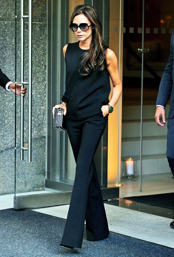How to look taller: Victoria Beckham in a black top and trousers
