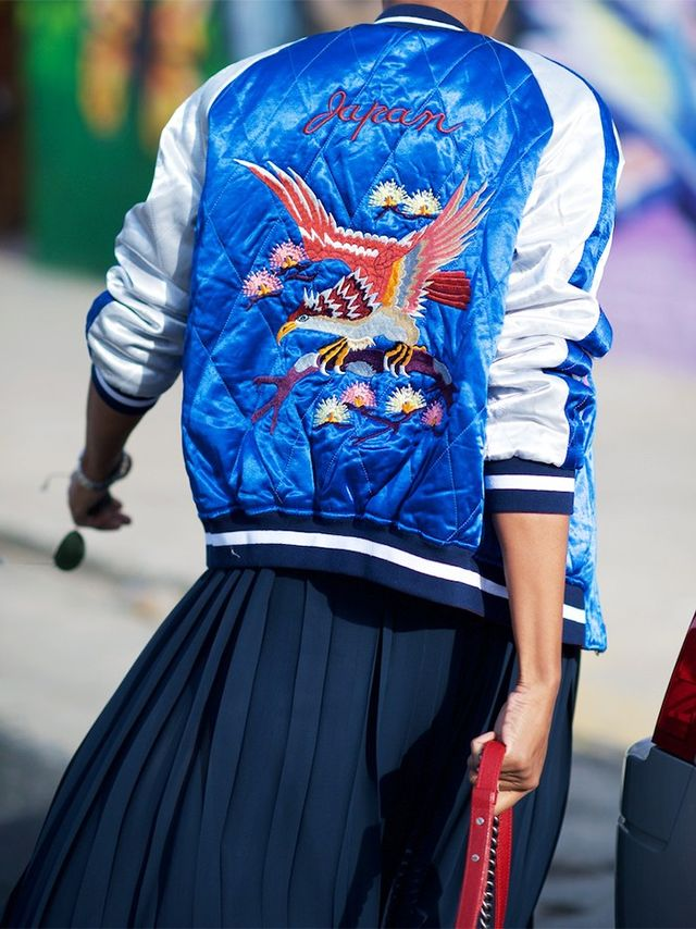 Bomber jackets aren't considered a weekend-only item in the city. Nay—we wear them with everything from pleated skirts to tailoredtrousers.
