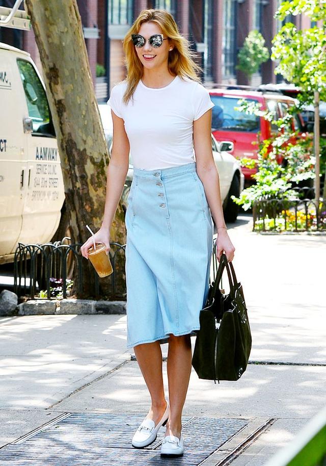 On Karlie Kloss: Fendi Eyeshine Sunglasses in Dark Ruthenium (£460); Acne Studios Kady Asymmetric Denim Midi Skirt in Sky Blue Denim (£210); Balenciaga Papier A4 SideZip Around...