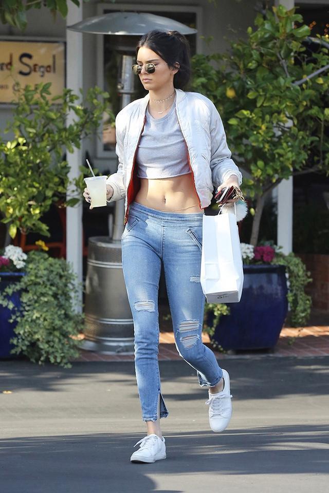 On Kendall Jenner: Jacquie Aiche Diamond Shaker Necklace (£3671); Lola James Mini Me Friendship Necklace (£67); Louis Vuitton Key Pouch (£220); Fendi bag charm; RtA Sonia Legging...