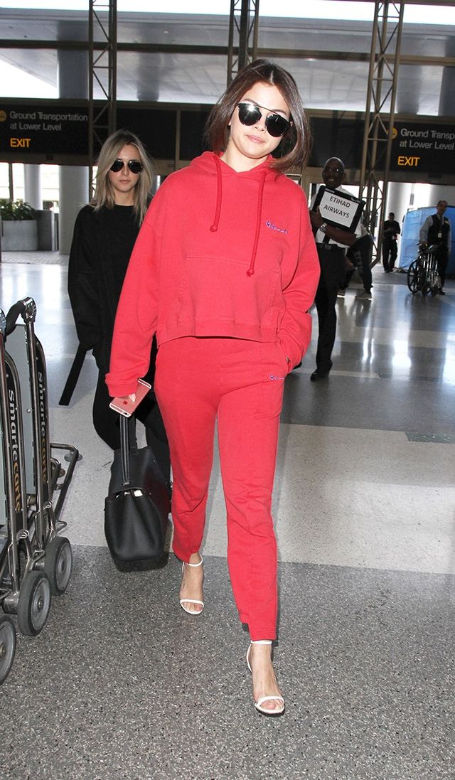 On Selena Gomez: Dior So Real Sunglasses (£448); Louis Vuitton Trocadero Bag (£1750); Vetements sweatshirt and Cut-Out Cuffs Track Pants (£375); Jimmy Choo Minny Leather Sandals...