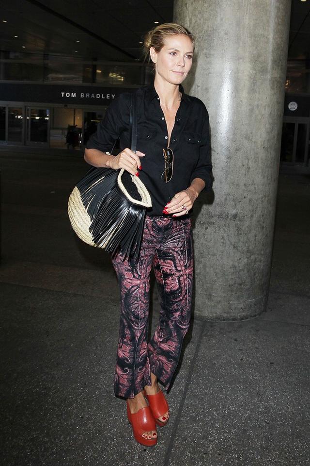 On Heidi Klum: Tom Ford Marko Sunglasses (£282); Saint Laurent Fringed Straw Tote (£690).